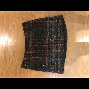 Tweed mini skirt with front zipper pockets